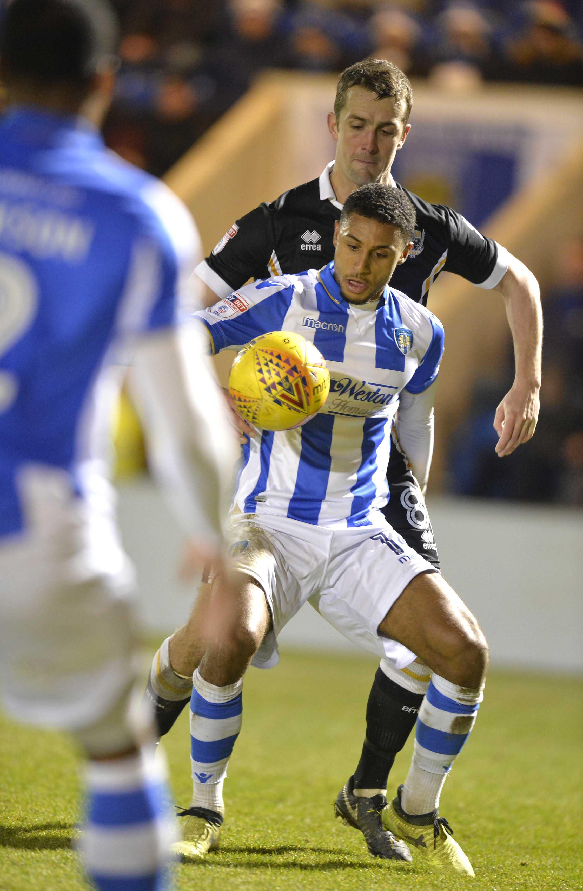 Midfield tussle - Brandon Comley in action for Colchester United in their 1-1 draw with Port Vale Picture: STEVE BRADING