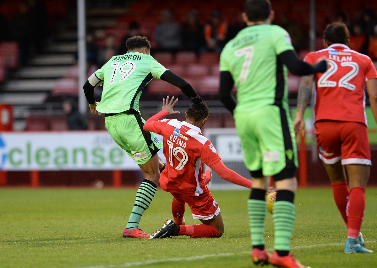 On target - Mikael Mandron fires home an early goal for Colchester United at Crawley Town Picture: WARREN PAGE