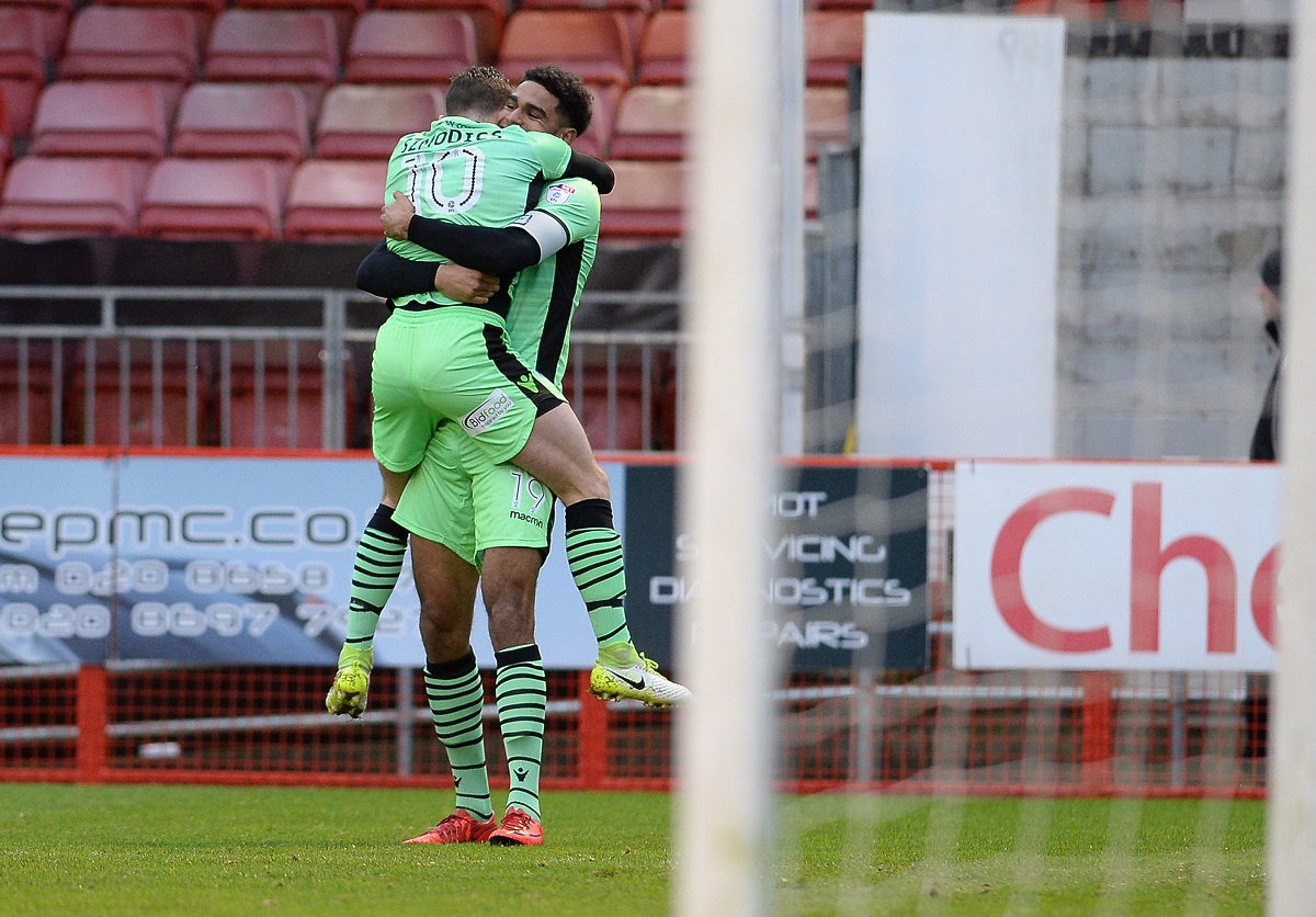 Celebration - Mikael Mandron celebrates his opener at Crawley Town with team-mate Sammie Szmodics in Colchester United's 2-0 win Picture: WARREN PAGE