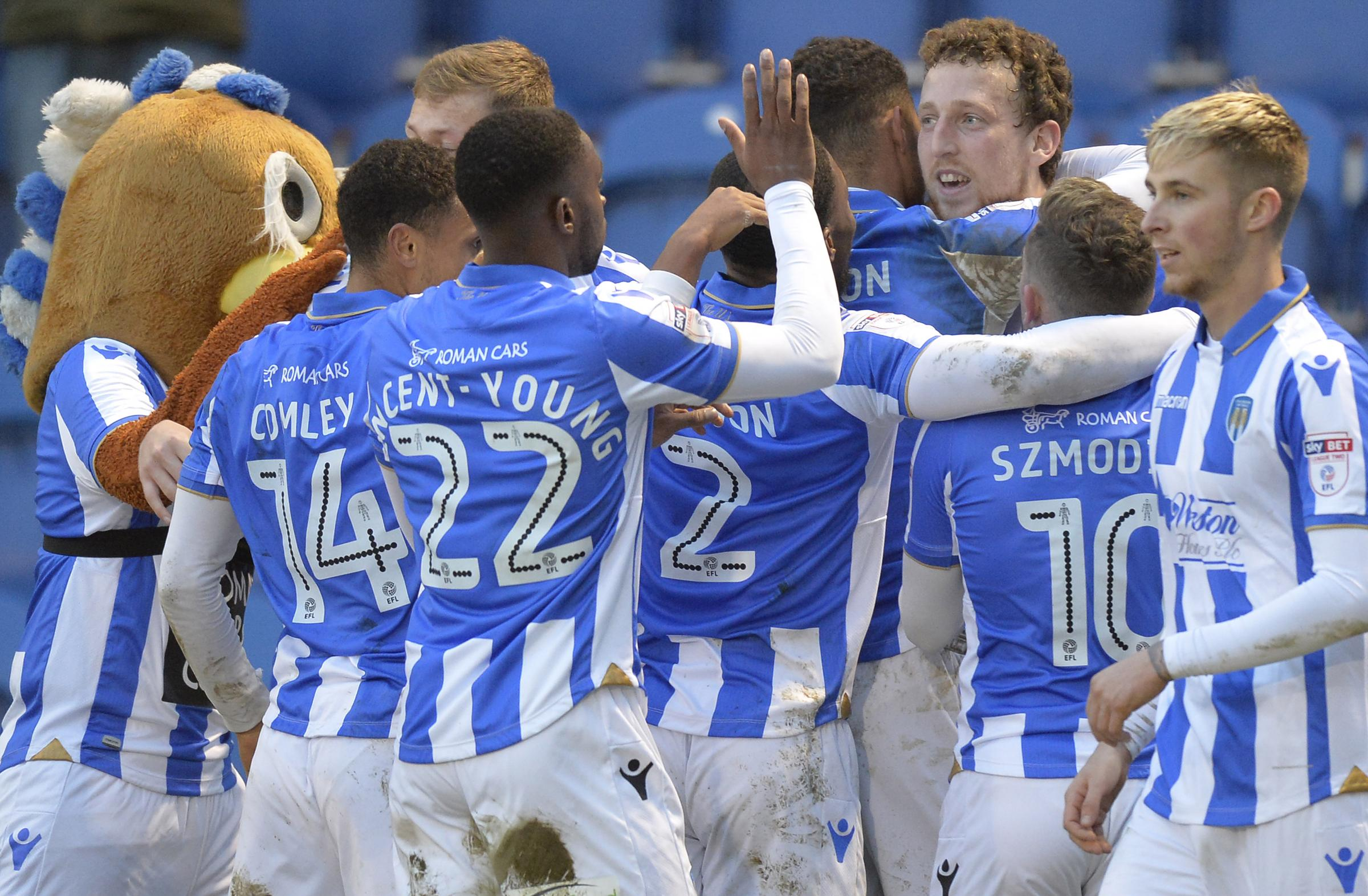 Big win - Colchester United's players celebrate Tom Eastman's goal against Newport County Picture: STEVE BRADING