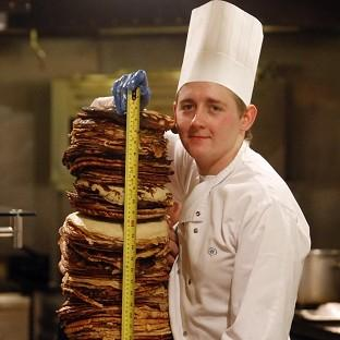 Harwich and Manningtree Standard: Chef Sean McGinlay attempts a world record to create the world's tallest pancake stack