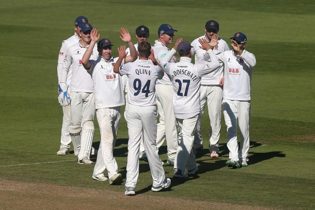 Essex's Matt Quinn celebrates with his team-mates after taking the wicket of Jason Roy Picture: Gavin Ellis/TGS Photo