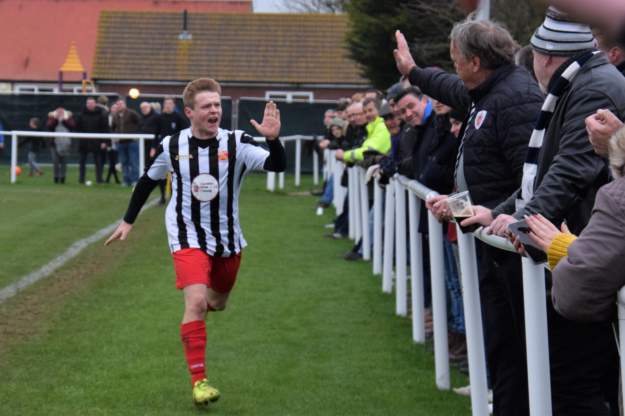 High fives: Harwich and Parkeston hero Tyler Rose is congratulated by Shrimpers chairman Tony Armstrong, after scoring in the Boxing Day derby at Little Oakley. Picture: Chris Smith