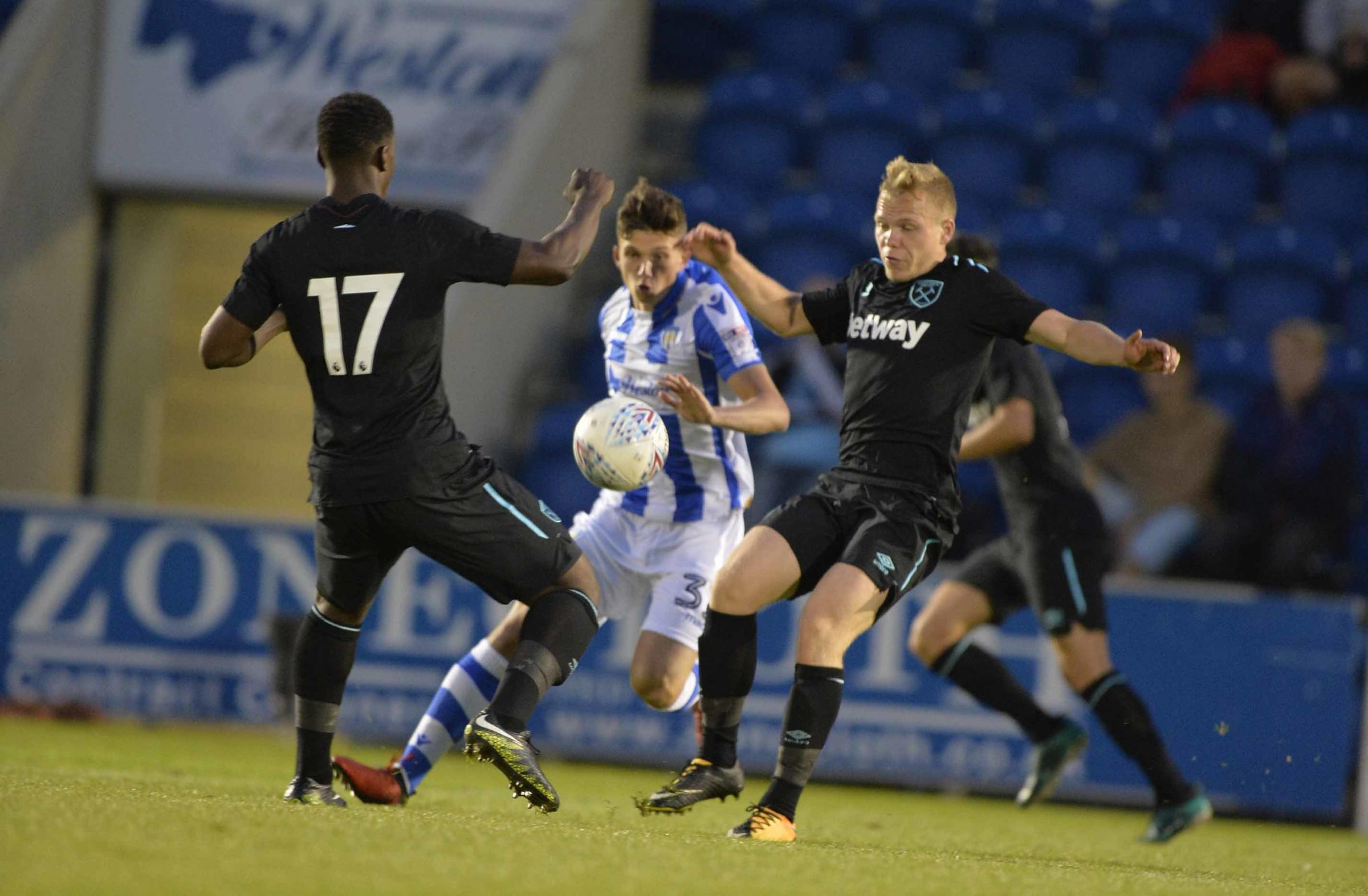 No way through - Louis Dunne featured in Colchester United under-23s' 5-0 defeat to Fulham Picture: STEVE BRADING