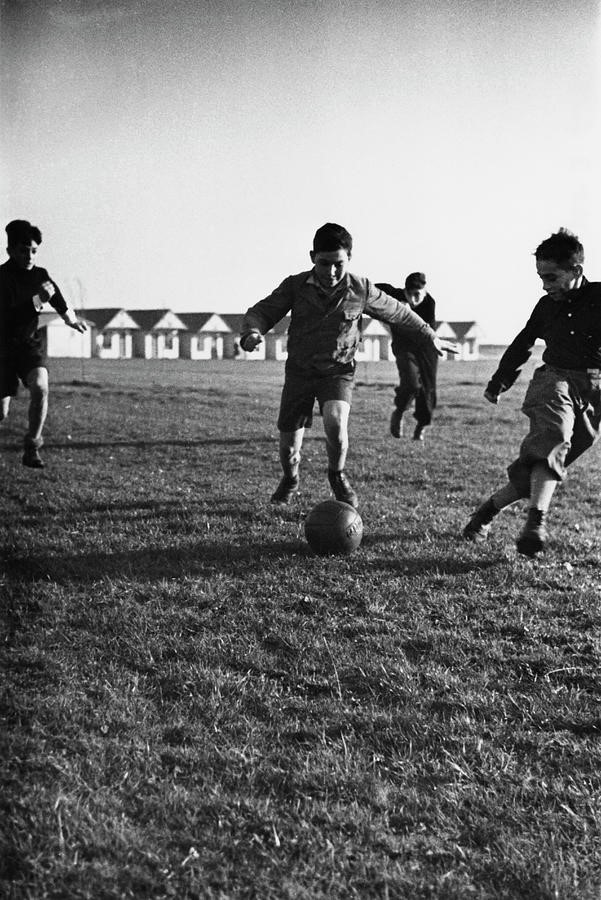 Kurt Hutton's photograph in 1938 of Kindertransport children playing football in Harwich