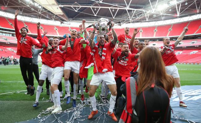 Magic moment - Salford City players celebrate with the trophy after winning the Vanarama National League Play-off Final at Wembley Picture: PA WIRE/BRADLEY COLLYER