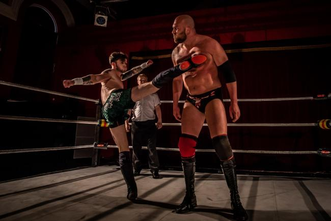 STANDING TALL: Harry Mant taking on Cody Hall. Photo from Matthew Mallet, JRM Photography